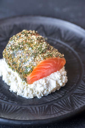 Salmon in mint sauce with herbs and ricotta Stock Photo