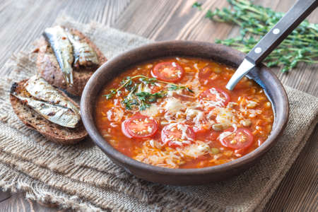 Portion of green lentil tomato soup with toasts Stock Photo