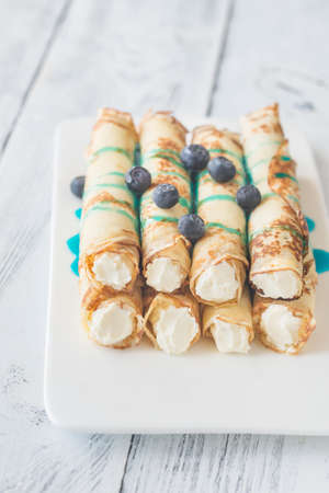 Crepes with cream cheese and fresh blueberries