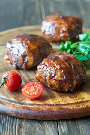 Meatballs wrapped in bacon on the wooden board Stock Photo