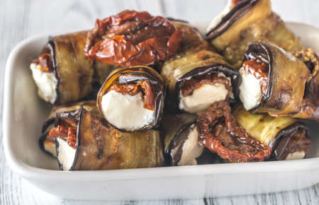 Aubergine rolls with cream cheese and sun-dried tomatoes