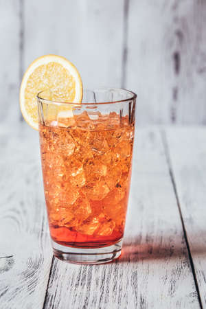 Glass of Aperol Spritz cocktail on the white wooden background