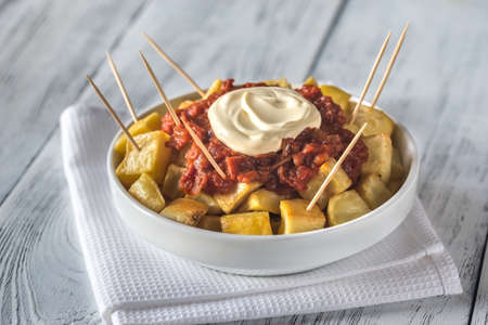 Portion of patatas bravas with sauces