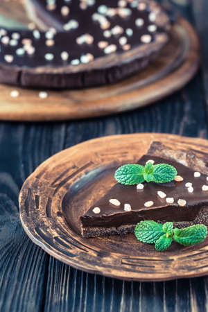 Portion of chocolate salted tart