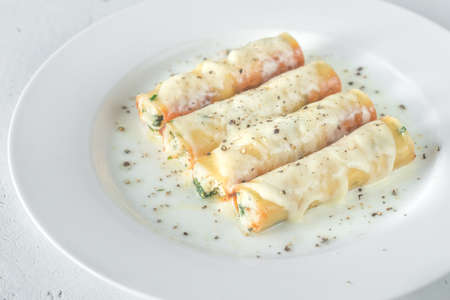 Cannelloni stuffed with ricotta on the white plate 版權商用圖片