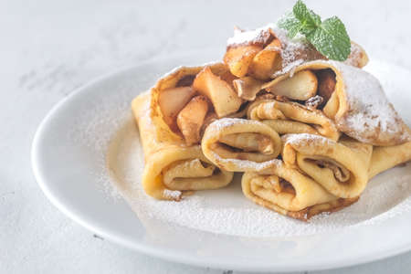 Crepes with apple slices Stock Photo