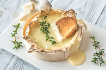 Baked Camembert cheese with toasted bread slices