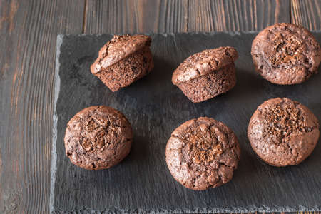 Chocolate muffins on the black stone board
