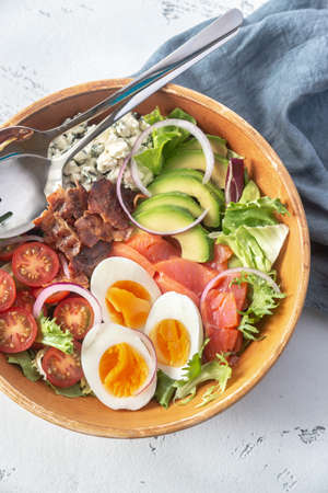 Bowl of Cobb salad on the table Archivio Fotografico