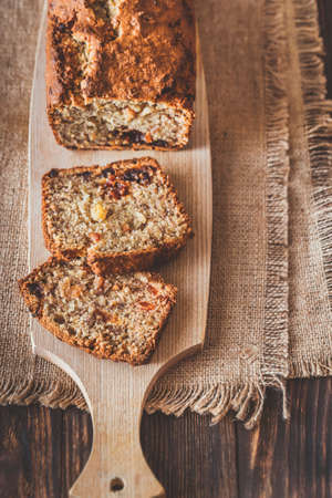 Loaf of banana bread on the wooden board: cross section Stock Photo