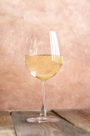 Glass of white wine on the old-fashioned background