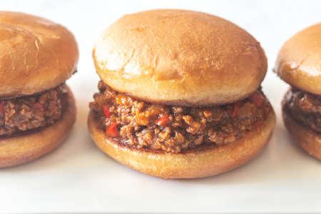 Sloppy joe - American sandwich on the white plate close up Imagens