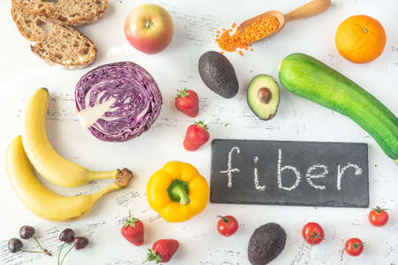 Foods rich in fiber on the white  background: top view