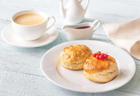 Classic scones with cream and red currant jam