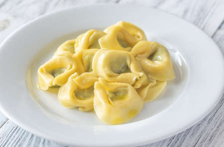 Portion of tortelloni stuffed with ricotta Stock Photo