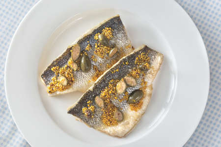 Baked sea bass with capers and fried potatoes