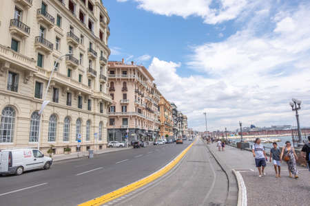 NAPLES, ITALY - JULY 16, 2019: Via Nazario Sauro, packed with restaurants and hotels provide you with a beautiful view of the bay of Naples.