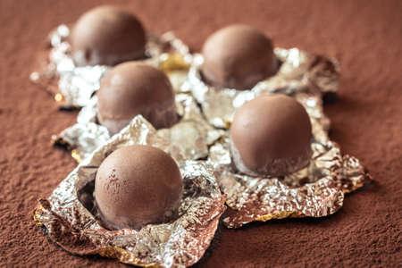 Chocolate truffles on cocoa  close-up Banco de Imagens
