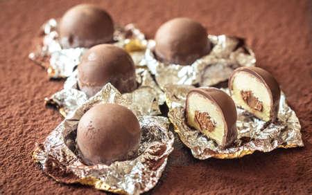 Chocolate truffles on cocoa close-up