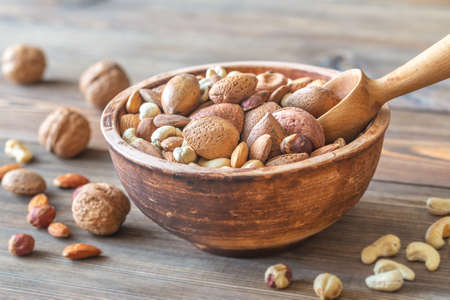 Bowl of nuts on the wooden close-up