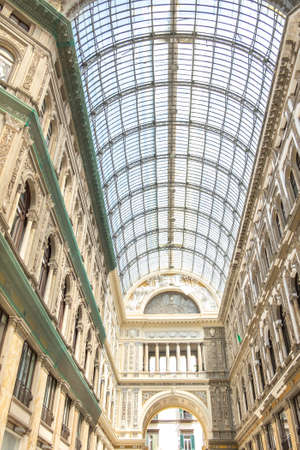 NAPLES, ITALY - JULY 16: Galleria Umberto I on July 16, 2019. Galleria Umberto I is a public shopping gallery in Naples, a high and spacious cross-shaped structure, surmounted by a glass dome.
