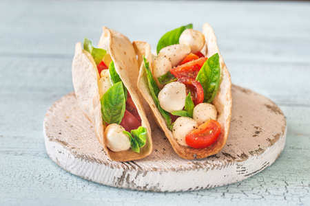 Caprese tacos on the wooden board