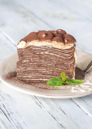 Slice of tiramisu crepe cake on the plate