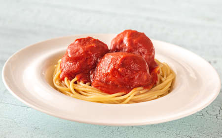 Portion of meatballs with tomato sauce and pasta