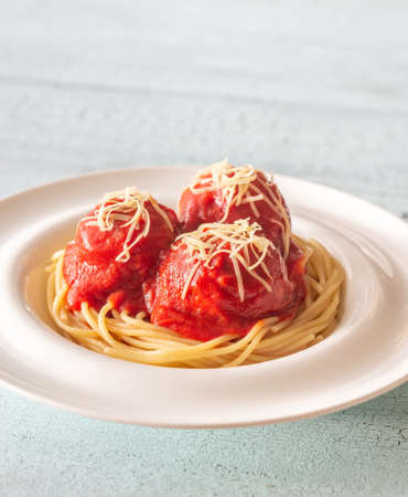 Portion of meatballs with tomato sauce and pasta: top view Stock Photo