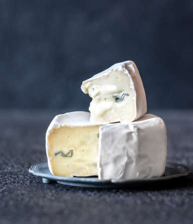 Soft cheese with white and blue mold: cross section