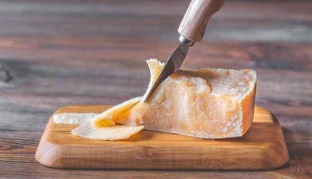 Parmesan cheese on the black stone board Standard-Bild - 133908496