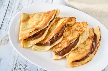 Crepes with chocolate cream close up