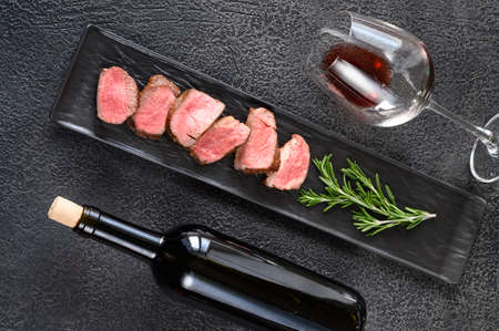 Bottle of red wine with sliced filet mignon: top view Stock Photo