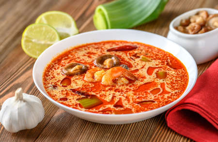 Portion of Tom Yum - famous Thai soup with ingredients