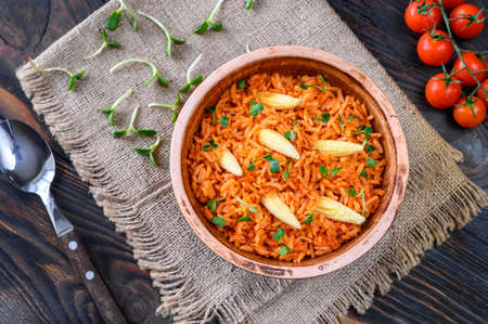 Bowl of Mexican rice on the wooden table