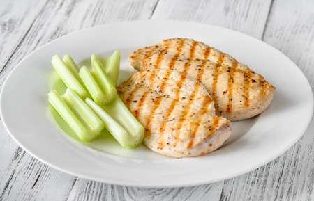 Grilled chicken garnished with celery stalks