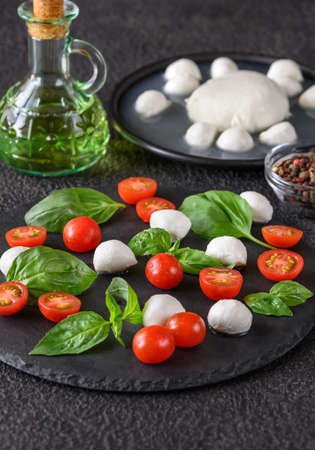 Caprese Salad made of mozzarella, tomatoes, and sweet basil Stock Photo