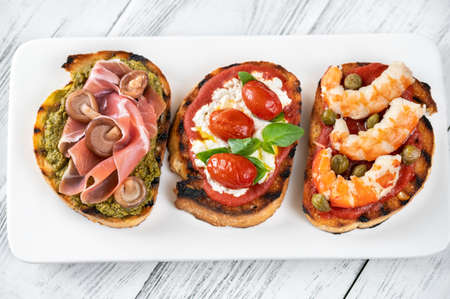 Assortment of Italian bruschettas with different toppings
