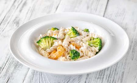 Fusilli pasta with broccoli, shrimps and creamy sauce Reklamní fotografie