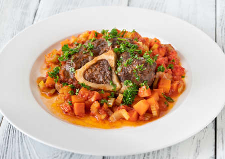 Ossobuco - Italian cuisine specialty with veal shanks and vegetables
