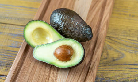 Fresh avocado on the wooden board Stok Fotoğraf