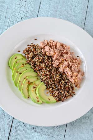 Quinoa with avocado and tuna flat lay