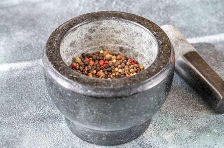 Grinding of peppercorn mix in granite mortar