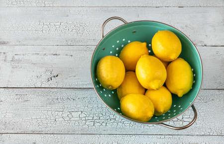 Fresh lemons in the colander: top view