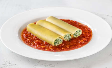 Cannelloni pasta stuffed with ricotta and spinach with tomato sauce Stock fotó