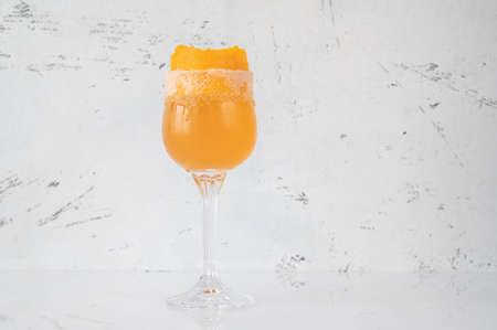 Glass of Brandy Crusta cocktail garnished with orange zest