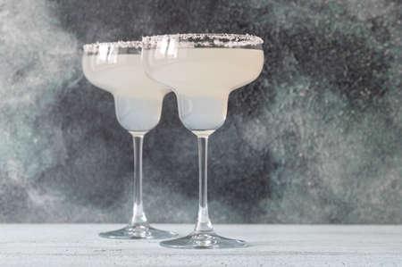 Glasses of Margarita cocktail garnished with salt rim