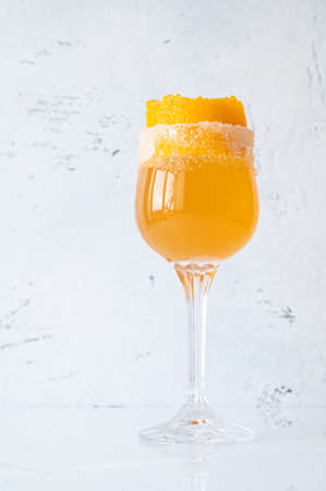 Glass of Brandy Crusta cocktail garnished with orange zest Imagens