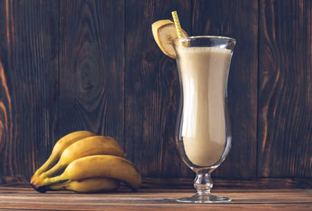 Glass of Dirty Banana Cocktail on wooden background