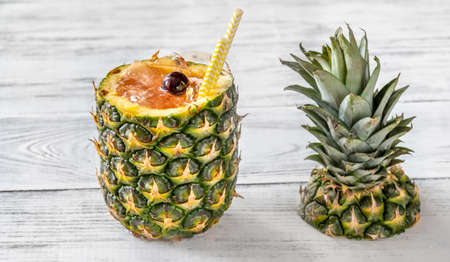 Bahama Mama Cocktail served in hollowed out fresh pineapple Stock Photo